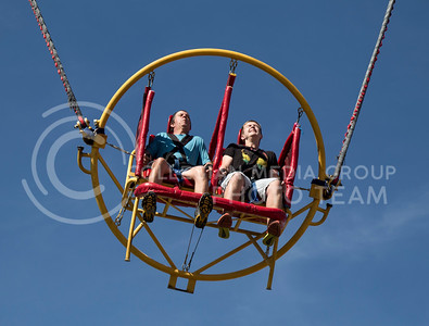 Corey and Hunter Spoon experience the slingshot ride at the state fair in Hutchinson, Ks Sept. 12, 2015. The fair ran from Sept. 11 to Sept. 20.  (Nathan Jones | The Collegian)