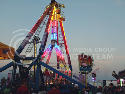 Crowd eagerly awaits their chance to ride the Freak Out at the Kansas state fair, on the evening of Sept. 12, 2015. (Jessica Robbins | The Collegian)
