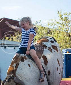Mckenna Lee, resident of Wichita, rides a mechanical bull at the Kansas State Fair in Hutchinson, Kansas on Sept. 12, 2015. (Cassandra Nguyen | The Collegian)