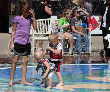 Group of children play in the water to cool down at the Kansas state fair in Hutchinson on Sept. 12, 2015. (Jessica Robbins | The Collegian)