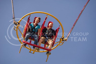 Britney Kinast (left) and Travis Kinast, Hutchinson residents, ride a bungee catapult during the Kansas State Fair on Sept. 12, 2015. (George Walker | The Collegian)