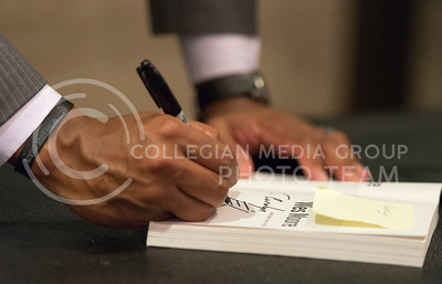 "Wes Moore, author of ""The Other Wes Moore,"" signs a book in the lobby of McCain Auditorium on Oct. 14, 2015. (George Walker 