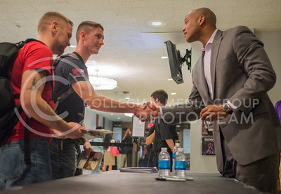 "Michael Molloy, junior in secondary education and U.S. Army combat veteran, waits to get his book signed as Joshua Ash, freshman in history and ROTC cadet, shakes hands with Wes Moore, author of ""The Other Wes Moore,"" after getting his book signed in the lobby of McCain Auditorium on Oct. 14, 2015. (George Walker 