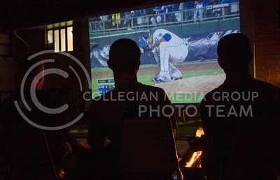 Members of FarmHouse Fraternity watch The Royals in the first game of The World Series outside on a projecter at their first philanthropy event, Kakes for Kaiden, on Oct. 27, 2015. (Regan Tokos | The Collegian)