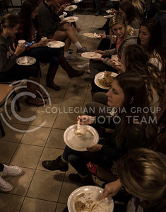 A group of girls eat pancakes at the FarmHouse philanthropy event, Kakes for Kaiden, on Oct. 15, 2015. (Regan Tokos | The Collegian)