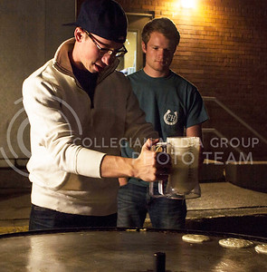 Kash Farney, sophomore in political science, pours pancake batter on the griddle before the Kakes for Kaiden event hosted by FarmHouse Fraternity on Oct. 27, 2015. (Regan Tokos | The Collegian)