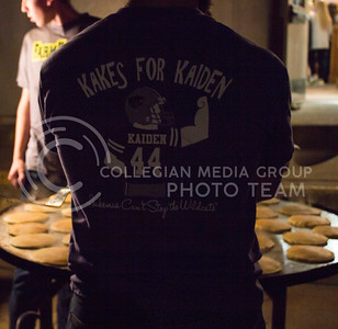 Austin Savage, sophomore in kinesiology, stands watching pancakes cook at the FarmHouse Fraternity philanthropy event, Kakes for Kaiden, on Oct. 27, 2015. (Regan Tokos | The Collegian)