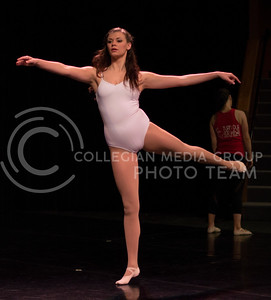 A participant of the School of Music, Theatre, and Dance department warms up before the start of the production of the 2015 Winter Dance during dress rehearsal on Dec. 1, 2015 in Mark A. Chapman Theatre. (Jessica Robbins   The Collegian)