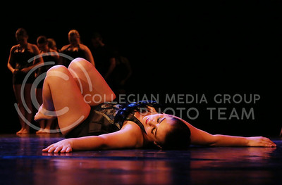 """Kristin Chase, a senior in theatre, performed """"Story of a Life"""" in the Mark Chapman Theatre during the dress rehearsal of Winter Dance on Dec 1, 2015. (Rachael Cunningham   The Collegian)"""