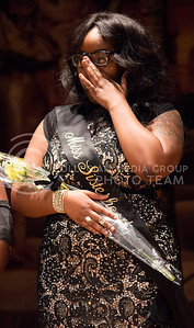 Tiffani Wilson, junior in criminology, recieves the title of Miss Sisterhood at the Miss Black and Gold Pageant in Forum Hall at the K-State Student Union on Dec. 5, 2015. (Miranda Snyder | The Collegian)