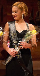 Bricelis Jimenez, freshman in animal science and industry, recieves the title of Miss Swimwear in the Miss Black and Gold Pageant at Forum Hall in the K-State Student Union on Dec. 5, 2015. (Miranda Snyder | The Collegian)
