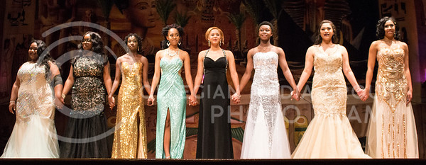 The eight contestants for the Miss Black and Gold Pageant hold hands as they await the announcement of the winners on Dec, 5, 2016 in Forum Hall at the K-State Student Union. (Miranda Snyder | The Collegian)