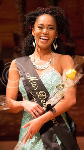 Eliza Scott, senior in publice relations, recieves the title of Miss Dedication at the Miss Black and Gold Pageant in Forum Hall at the K-State Student Union on Dec. 5, 2015. (Miranda Snyder | The Collegian)