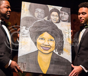 Alpha Phi Alpha fraternity presented a portait to Myra Gordon, associate provost for diversity, at the Miss Black and Gold Pageant in Forum Hall on Dec. 5, 2015. The portrait was painted by a member of the fraternity, and was presented for all the work she has done for students of color. (Miranda Snyder | The Collegian)