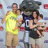 A family poses with Willie the Wildcat during Purple Power Play in city park on Sept. 3, 2015.  Numerous activities and events were offered during the evening.  (Rodney Dimick | The Collegian)