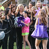 The Classy Cats encourage a future potential Classy Cat during Purple Power Play in Manhattan City Park on Sept. 3, 2015.  (Rodney Dimick | The Collegian)