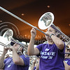 The trombone section of the Pride of Wildcat Land blare their brass during the pep rally in Purple Power Play at Manhattan City Park on Sept. 3, 2015.  (Rodney Dimick | The Collegian)
