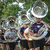 The tuba players march into Manhattan City Park during Purple Power Play on Sept. 3, 2015.  The Pride of Wildcat Land performed for the attendees toward the end of the event.  (Rodney Dimick | The Collegian)
