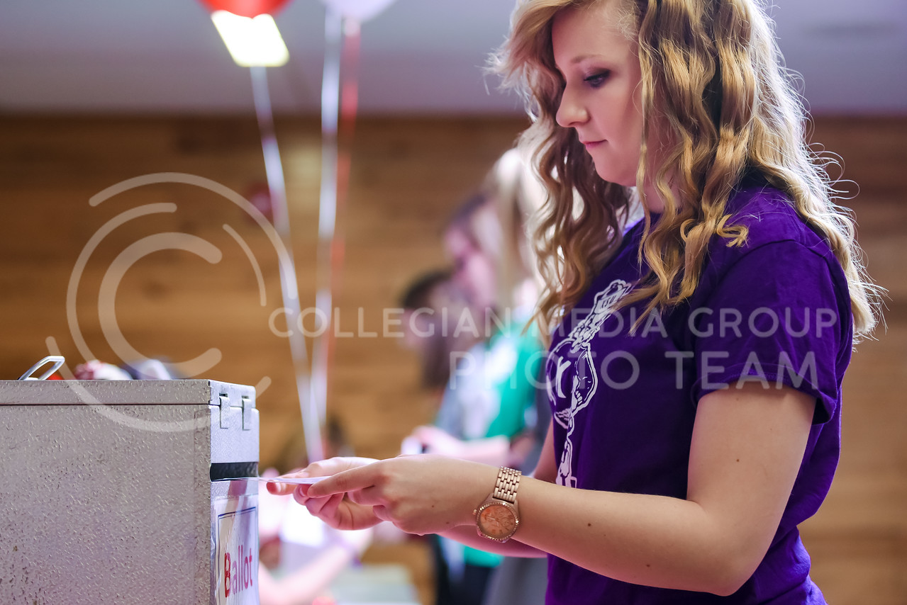 Grace Heidebrecht, senior in psychology, drops her ballot in the ballot box at the Riley County Republican Party Presidential Caucus Mar. 5, 2016, at Manhattan High School. (Parker Robb   The Collegian)