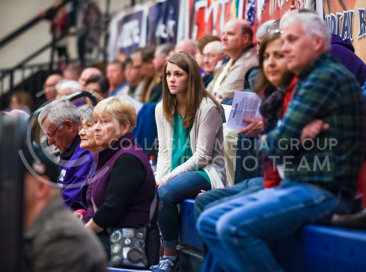 Early attendees listen to speeches endorsing the various Republican presidential candidates at the Riley County Republican Party Presidential Caucus Mar. 5, 2016, at Manhattan High School. (Parker Robb   The Collegian)