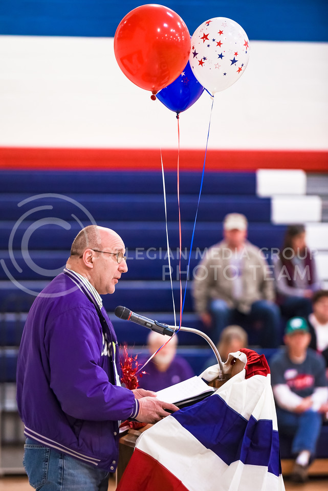 Roger Seymour, Manhattan resident, endorses Rebublican presidential candidate Donald Trump as attendees listen at the Riley County Republican Party Presidential Caucus Mar. 5, 2016, at Manhattan High School. (Parker Robb   The Collegian)