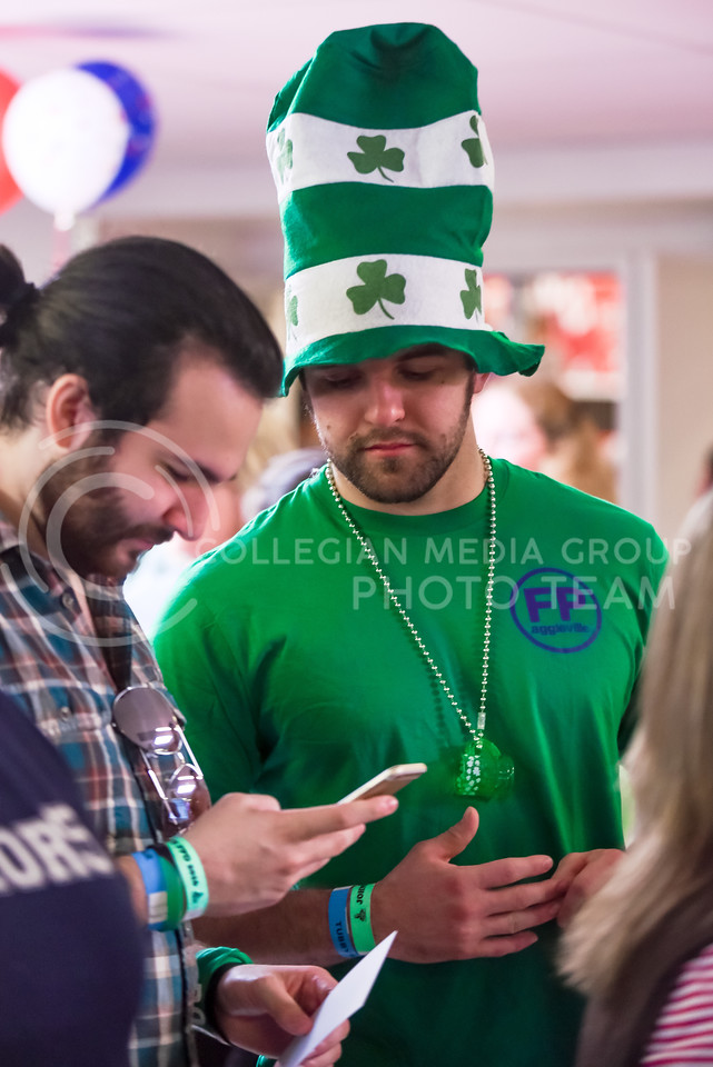 A voter decked out in Fake Patty's Day apparel stands in line to vote at the Riley County Republican Party Presidential Caucus Mar. 5, 2016, at Manhattan High School. The Kansas Caucuses fell on the same day as Fake Patty's Day this year, but that did not stop K-Staters from both doing their civic duty and having fun in Aggieville. (Parker Robb   The Collegian)