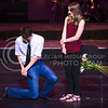 K-State Singer Mark Hay, senior in theater, proposes to girlfriend Ali Dawes, '15 graduate in communication sciences and disorders, on stage during the Singers' portion of their joint concert with In-A-Chord Apr. 22, 2016, in McCain Auditorium. (Parker Robb | The Collegian)