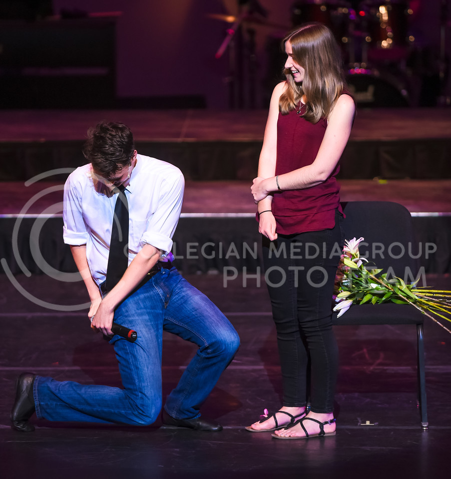K-State Singer Mark Hay, senior in theater, proposes to girlfriend Ali Dawes, '15 graduate in communication sciences and disorders, on stage during the Singers' portion of their joint concert with In-A-Chord Apr. 22, 2016, in McCain Auditorium. (Parker Robb   The Collegian)