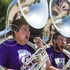 """Tuba players of the K-State Marching Band shout while performing """"The Band is Hot!"""" at the K-State Student Union renovation groundbreaking ceremony Wednesday afternoon. (Parker Robb 