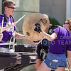 The K-State Marching Band's cymballist dances while a drummer hits her cymbal at the K-State Student Union renovation groundbreaking ceremony Wednesday afternoon. (Parker Robb | The Collegian)