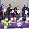 Union leadership attempts to pin a construction hard hat on Willie's head at the K-State Student Union renovation groundbreaking ceremony Wednesday afternoon. (Parker Robb | The Collegian)