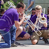 Trombonists of the K-State Marching Band perform the first verse of the Wabash Cannonball slowly and quietly as they crouch on the ground at the K-State Student Union renovation groundbreaking ceremony Wednesday afternoon. (Parker Robb   The Collegian)