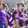 """Flag bearers of the K-State Marching Band alternate leaning and clapping during """"The Band is Hot!"""" at the K-State Student Union renovation groundbreaking ceremony Wednesday afternoon. (Parker Robb   The Collegian)"""