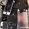 Broken iPhone parts sit discarded in a box Saturday at MHK iRepair in Aggieville. About 75-80% of the repairs the shop performs are replacements of cracked screens according to Ross Cunningham, MHK iRepair co-owner. (Parker Robb | The Collegian)