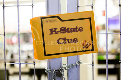 A clue hidden in the Student Union waits to be read during the campus-wide clue game Whodunnit, hosted by K-State After Hours on Oct. 30, 2015. (Emly Starkey | The Collegian)