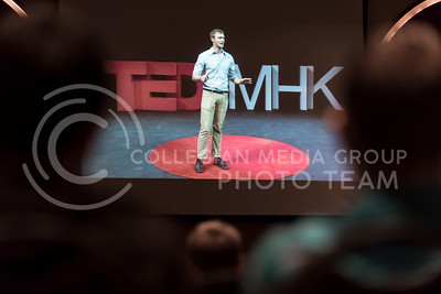 Jordan Thomas, senior in anthropology, through the TEDxMHK livestream broadcast in the Alumni Center Ballroom Feb. 1, 2016, tells of his experiences bicycling from Kansas to South America after deciding to take a gap year between his junior and senior years of college to discover who he is and what he wants to do. Along the way, he discovered that the world is full of very kind people who do not have much but are very happy, and he encourages people to overcome their fears of so-called dangerous places, get out and discover who they are individually and where humanity fits into the world. (Parker Robb | The Collegian)