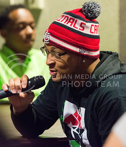 """Dominic White, junior in architecture, recites the words """"My Black is Beautiful"""" alongside fellow Black Student Union members at the Our Story Kings and Queens event sponsored by Black Student Union on Nov. 10, 2015 in the Student Union. (Cassandra Nguyen 