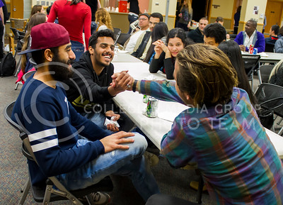 Wael Aljutayli, exchange student, Yasser Zalah, exchange student, and Hayden Wylie, sophomore in anthropoloy, say goodbye after eating Friendsgiving dinner together. International Buddies sponsored a thanksgiving themed dinner on November 13, 2015 for all international students and their buddies. (Renee Dick | The Collegian)