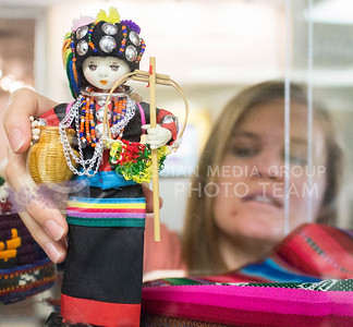 "Michelle Childs, administrative assistant of international programs, decorates a display case at the K-State Student Union for International Education Week on Nov. 13, 2015. The display cases are called ""The Many Worlds of International"" and will be on display through Nov. 20, 2015. (Miranda Snyder 