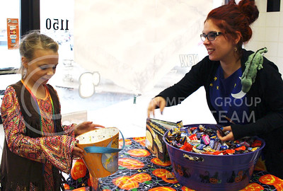 Susie Willi, Manhattan resident, hands out candy to trick-or-treaters at the Westloop Bewitching event on Oct. 30, 2015. (Miranda Snyder | The Collegian)