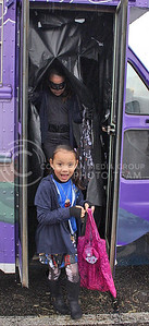 Evelyn Martinez, Manhattan resident, runs out of the Big Poppi Bicycle haunted bus at the Westloop Bewitching event on Oct. 30, 2015. (Miranda Snyder | The Collegian)