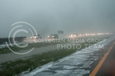 Travelers headed west on I70 slow down due to accumulations of hail on the highway after storms caused problems on Tuesday April 26, 2016. (Photo by Evert Nelson | The Collegian)