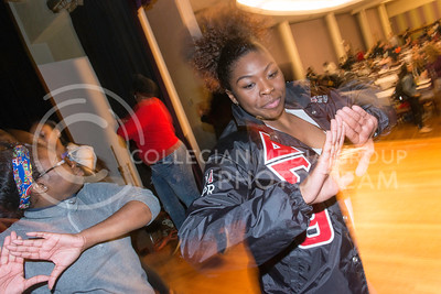 Ronesha Cobb, senior in marketing, dances with Ebony Paul, senior in apparel and textile marketing, and other girls on the stage in the Grand Ballroom of the Student Union on Feb. 17, 2016, during the 3rd Annual Black Student Leadership Conference. (Evert Nelson | The Collegian)