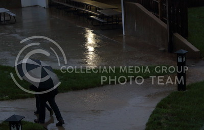 Jardine residents walk home during the storm on April 26, 2016.  (Miranda Snyder | The Collegian)