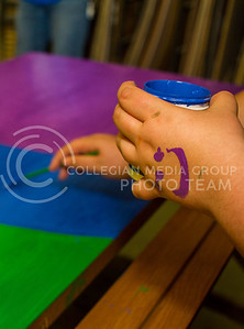 A member of LGBT and Allies paints on a door that will be used to celebrate National Coming Out Day on Oct. 12, 2015 in Bosco Plaza from 11 a.m. to 1 p.m. (Mason Swenson | The Collegian)