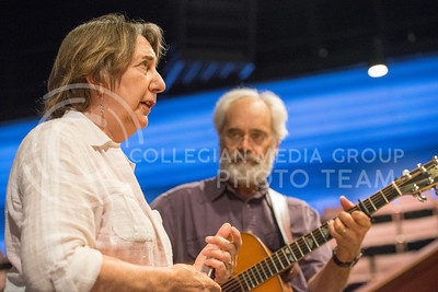 Musicians and activists Terry Leonino and Greg Artzner perform a song to interested Ebony Theater members in Nichols Theater on Sep. 8 ,2015. The performance was a preview for the duos performance Thursday. (Evert Nelson | The Collegian)