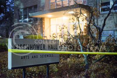 Caution tape in front of Eisenhower Hall outlines broken limbs that fell in front of the hall on Nov. 30, 2015. (Evert Nelson | The Collegian)