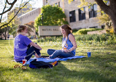 Gabi Biby, freshman in mechanical engineering and Alexandra Lashley, freshman in biology, share a laugh while sitting on a blanket in the Quad on April 14, 2016. (Emily Starkey | The Collegian)