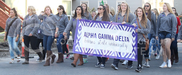 Members of Alpha Gamma Delta walk in K-State's Homecoming Parade on Oct. 16, 2015. (Miranda Snyder | The Collegian)