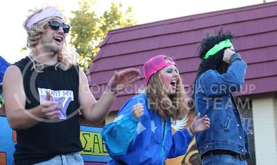 Members of Sigma Alpha Epsilon, Phi Delta Theta and Kappa Alpha Theta dance through Aggieville on their K-State Homecoming Parade float on Oct. 16, 2015. (Miranda Snyder | The Collegian)